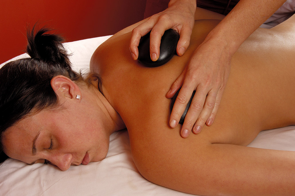 massage back with hot mineral stones